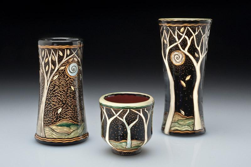 Decorated ceramic mugs by Terri Kern